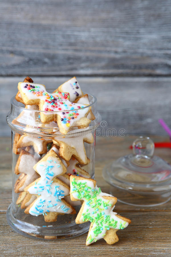 Christmas Cookies in a jar. Wooden background royalty free stock images