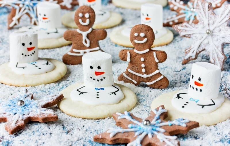 Christmas Cookies - melting snowman, gingerbread man, snowflake. Christmas Cookies - melting snowman, gingerbread man, gingerbread snowflake stock images
