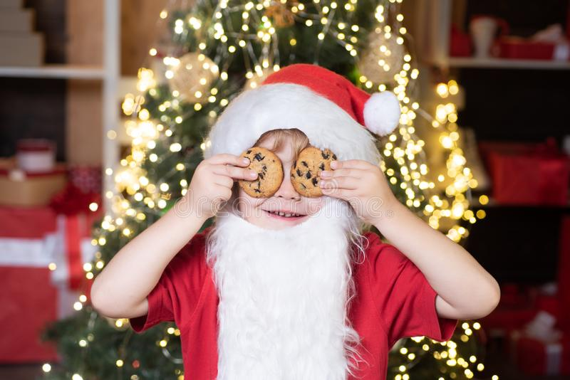 Christmas cookies and milk. Greeting Christmas card. Thanksgiving day and Christmas. Happy new year. Little Santa Claus. Kid with beard and mustache stock photography