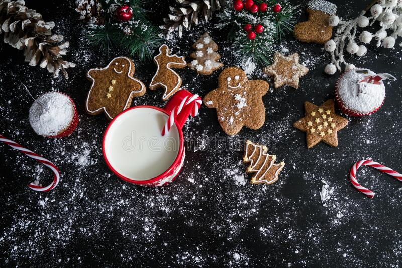 Christmas cookies muffins and milk stock images