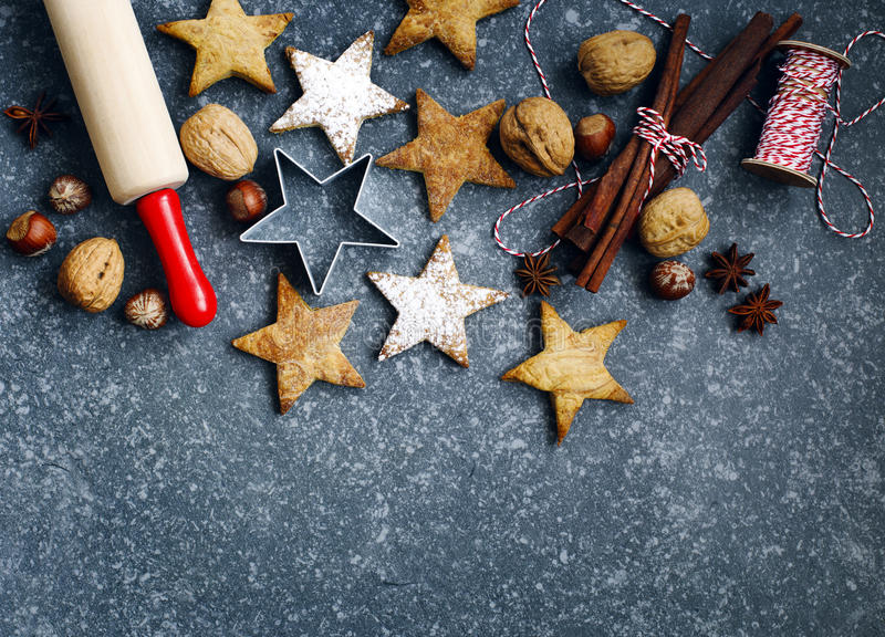 Christmas cookies, roller pin, cinnamon, nuts and cookie cutter. royalty free stock photography