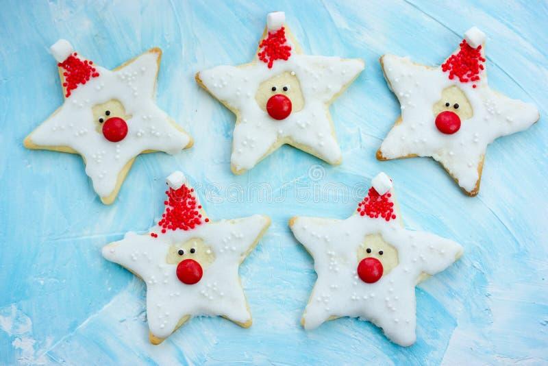 Christmas cookies santa claus, creative idea for treats kids, funny edible santas of star cookies recipe stock images