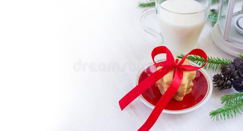 Christmas cookies for Santa and a glass of milk on a white backg royalty free stock image