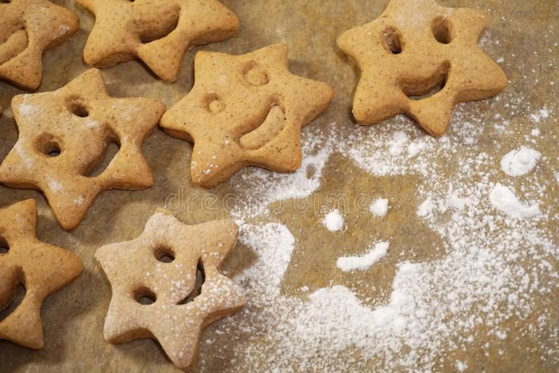 Christmas cookies with a smile face flat lay on the baking paper royalty free stock photography