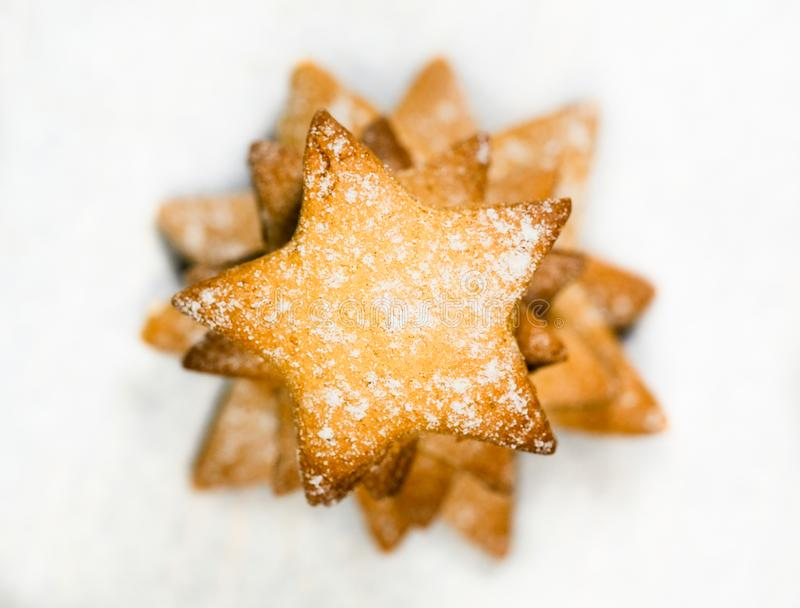Christmas cookies stars. On white paper background royalty free stock photography