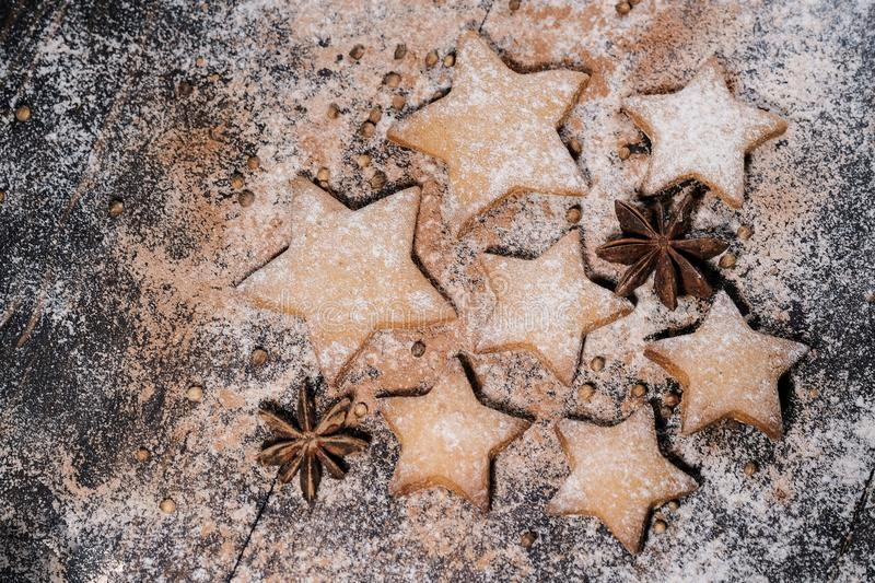 Christmas cookies stars. Christmas cookies on wooden background royalty free stock image