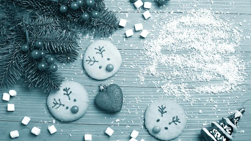 Christmas cookies and treats on the table. Sweet gifts for child stock image
