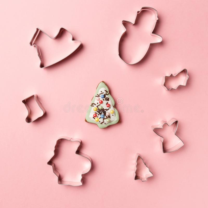 Christmas cookies various shape cutter on pink background. Top view. Flat lay. Trendy colorful photo royalty free stock photo
