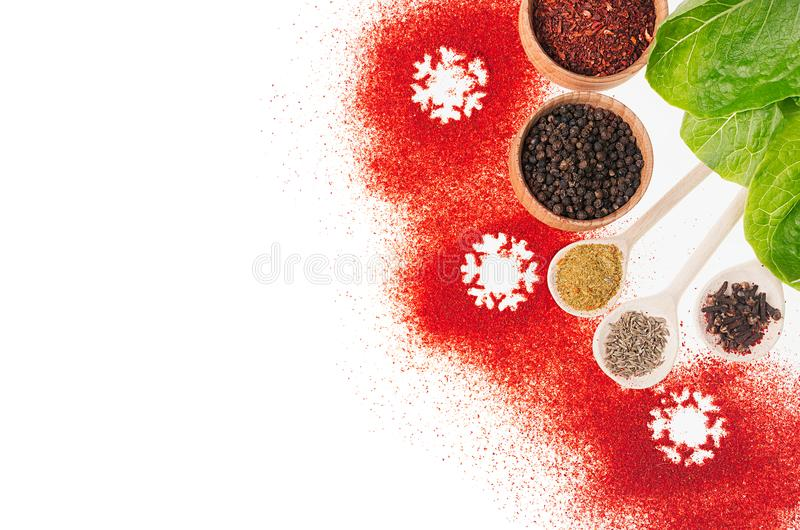 Christmas cooking - different dry spices, fresh green salad, snowflakes as decorative border, , top view. Christmas cooking - different dry spices, fresh green royalty free stock photos