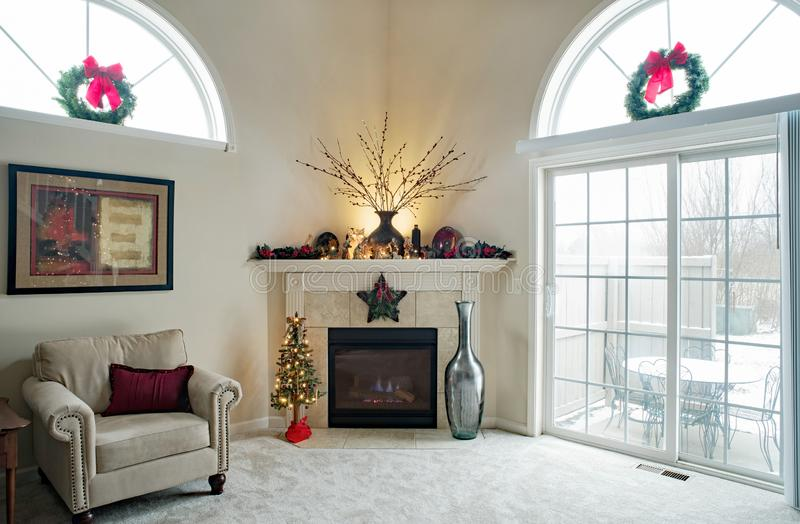 Christmas Corner Fireplace with Outdoor Winter Scene stock photo