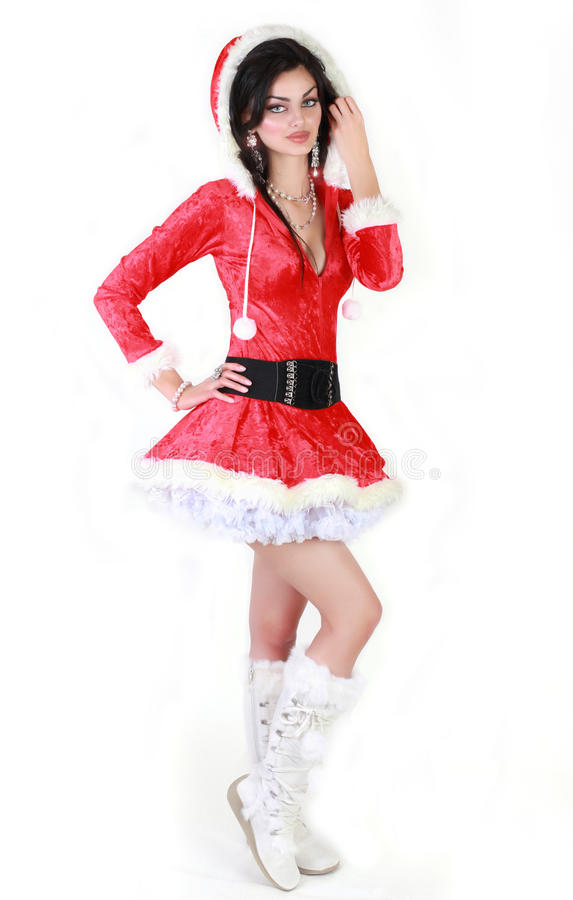 Christmas costume. Beautiful Young Woman Dressed In A Santa Costume royalty free stock images