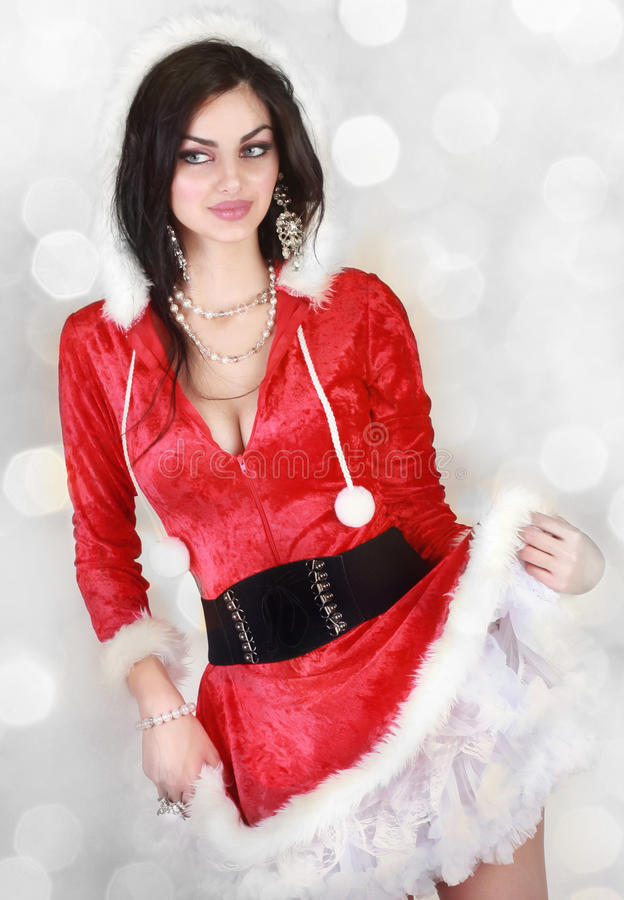Christmas costume. Beautiful Young Woman Dressed In A Santa Costume stock images