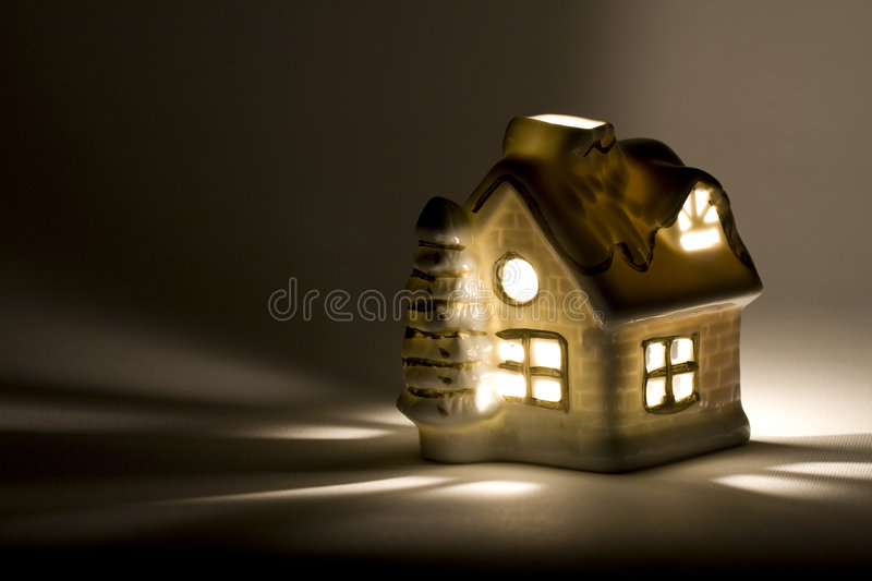 Christmas cottage. Christmas ceramic little cottage with candle inside royalty free stock images