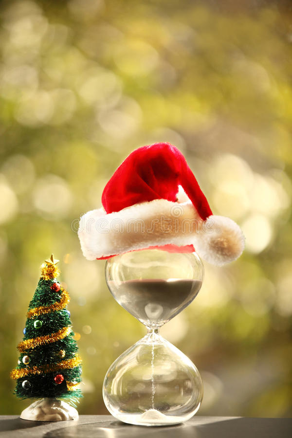 Christmas countdown. Modern Hourglass and Christmas tree stock photography