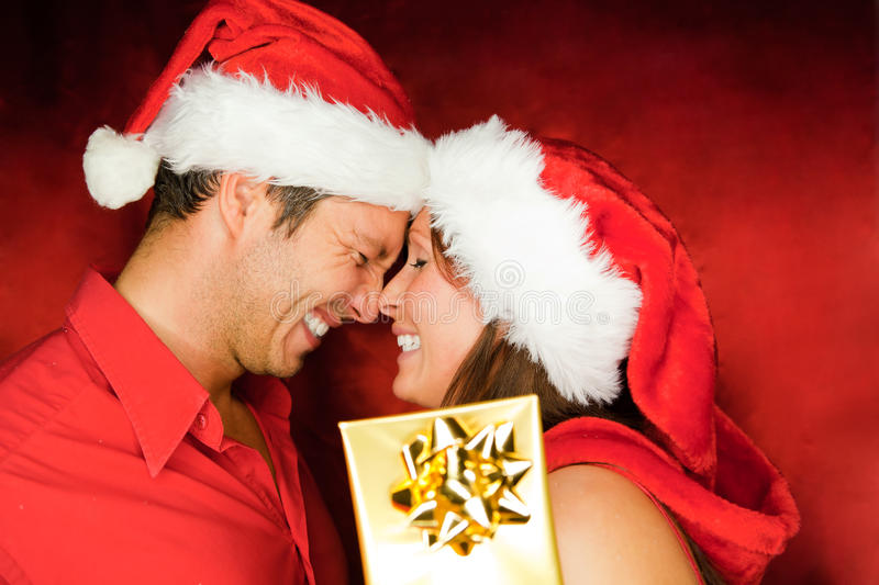 Christmas couple. Lovely christmas couple holding presents