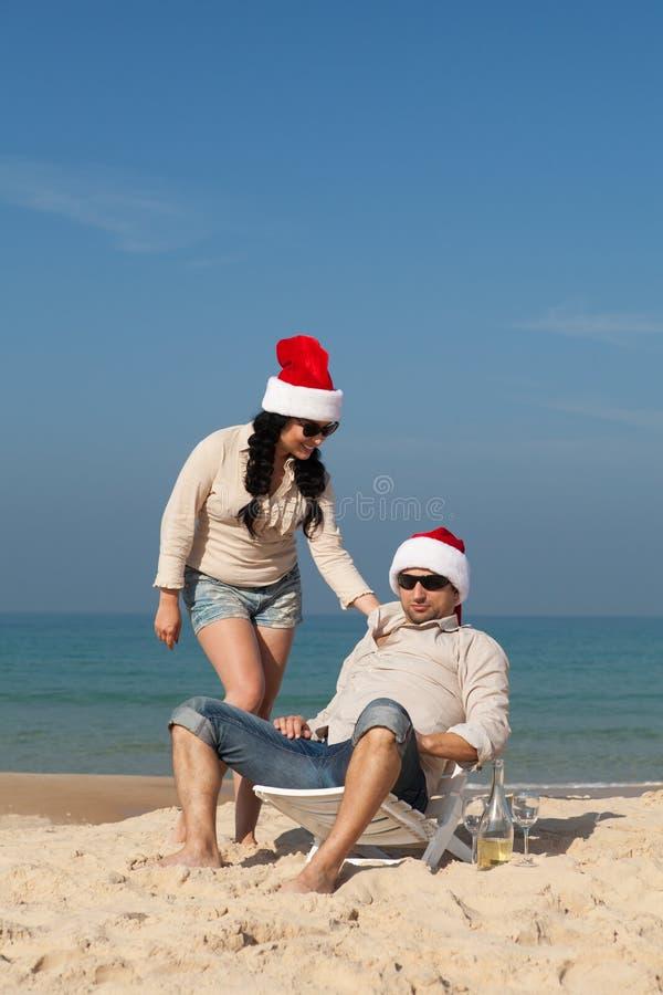 Christmas couple on a beach stock photo