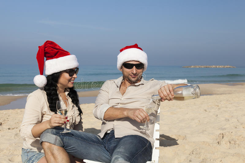 Christmas couple on a beach stock photography