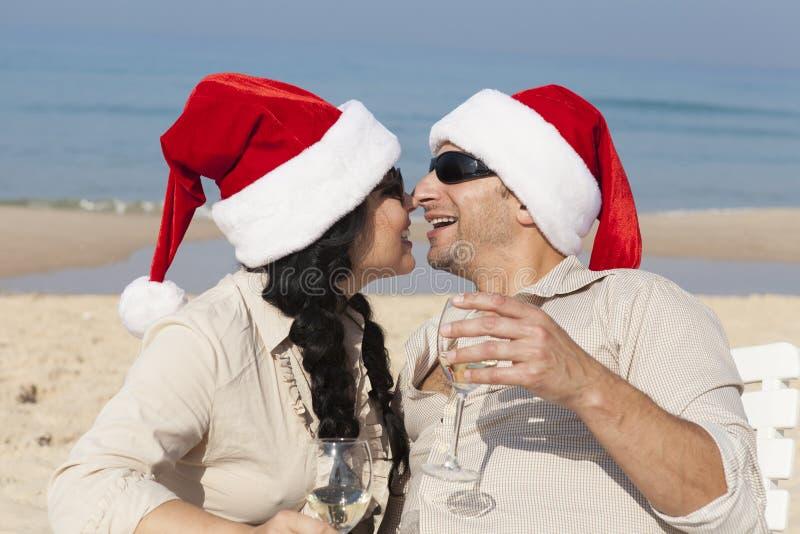 Christmas couple on a beach stock photos