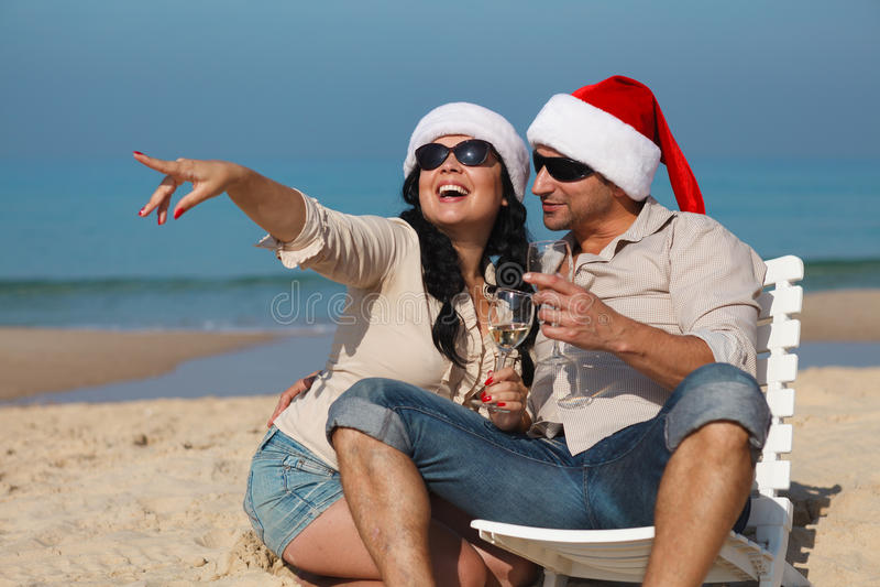 Christmas couple on a beach royalty free stock photography