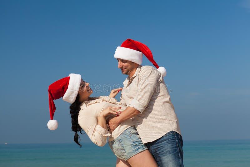 Christmas couple on a beach royalty free stock image
