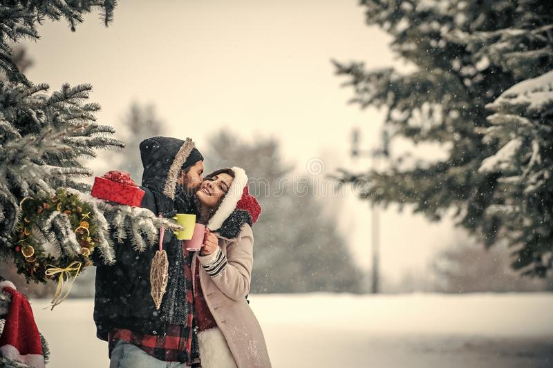 Christmas couple of happy man and woman drink hot wine. stock images