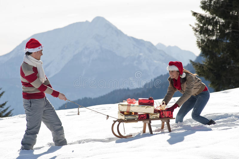 Download Christmas Couple Playing With Gifts In The Snow Stock Photo - Image: 27283522