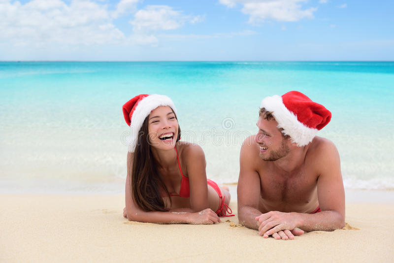 Christmas couple relaxing on beach winter vacation royalty free stock photo
