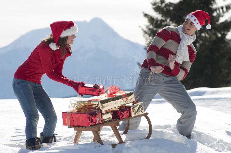 Christmas couple with sled royalty free stock photos