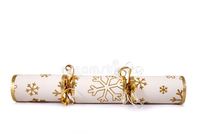 Christmas Cracker. A studio shot of a Christmas Cracker or otherwise known as a Bon Bon. A cracker consists of a cardboard tube wrapped in a brightly decorated stock photo
