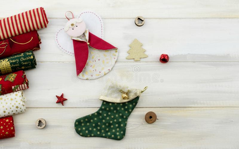 CHRISTMAS CRAFT BACKGROUNDS. PATCHWORK DIY ANGELS AND SOCKS TREE DECORATION AGAINST WHITE WOODEN BACKGROUND.  stock image