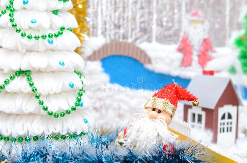 Christmas craft. Snowman and Santa Claus Christmas tree. Shallow depth of field royalty free stock photography