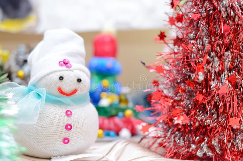 Christmas craft. Snowman and Santa Claus Christmas tree. Shallow depth of field royalty free stock photo