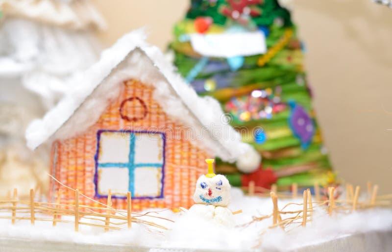 Christmas craft. Snowman and Santa Claus Christmas tree. Shallow depth of field stock image