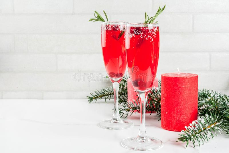Christmas cranberry mimosa. Christmas morning red cranberry mimosa with rosemary, white marble background copy space with christmas decorations royalty free stock photos