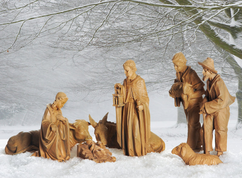 Christmas crib. Old christmas manger against a snowy landscape background stock images