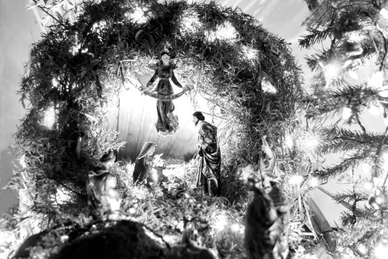 Christmas crib, color light. A black and white view stock photos