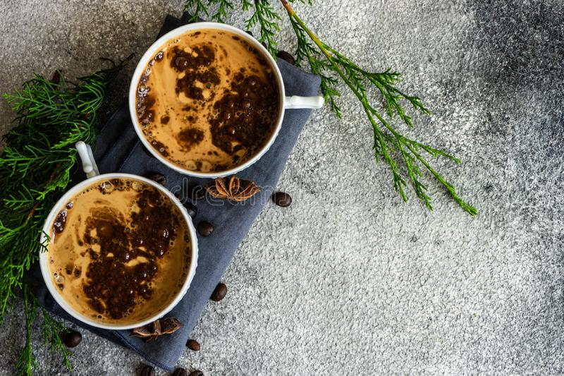 Christmas and cup of coffee. Cup of coffee and Christmas decor on rusty stone backgtound  with copy space stock image