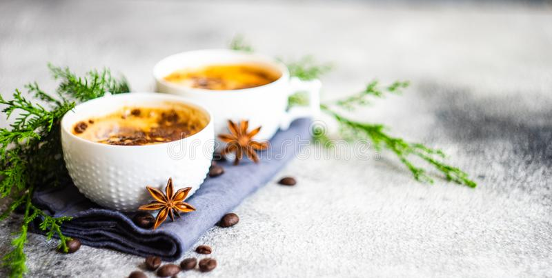 Christmas and cup of coffee. Cup of coffee and Christmas decor on rusty stone backgtound  with copy space royalty free stock image