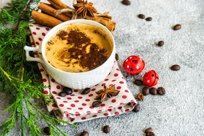 Christmas and cup of coffee. Cup of coffee and Christmas decor on rusty stone backgtound  with copy space stock photo