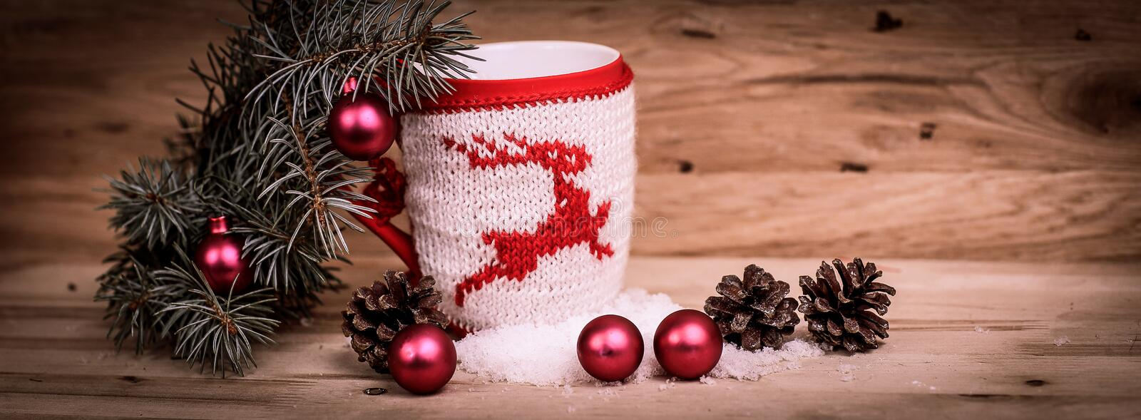 Christmas Cup ornament and Christmas decoration on wooden backgr. Ound.photo with copy space royalty free stock photography