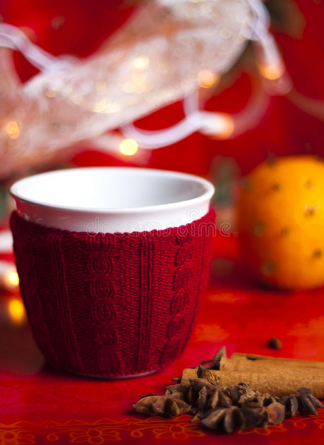 Christmas Cup in red knitted cover stock photo