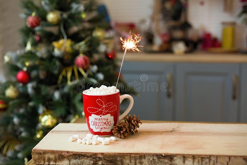 Christmas Cup and a Sparkler on the kitchen table. Christmas Cup of drink and a Sparkler on the kitchen table, time, copy, space, new, year, event, happy, winter stock photography