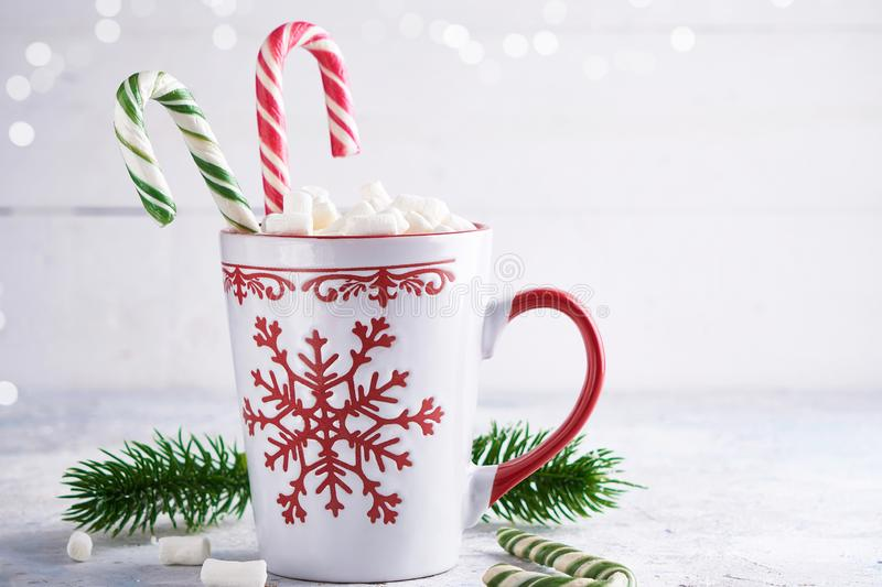 Christmas cup with sugar marshmallows and candy . Fir branches on light background Copy space. Christmas cup with sugar marshmallows and candy . Fir branches on stock photography
