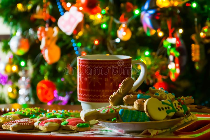 Christmas cup, tea and cookies. On the table stock photos