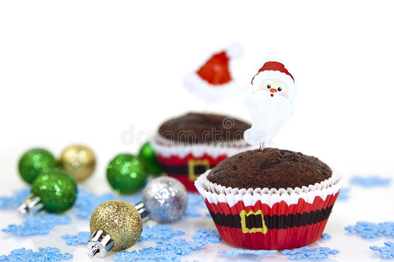 Christmas cupcake. Sweet christmas cupcake decorating with icing , sprinkles and candy on a white background stock photos