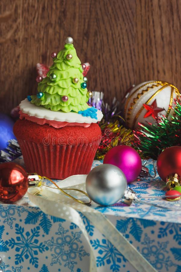 Christmas cupcake with colored decorations. Christmas Tree made from confectionery mastic, soft focus background stock images