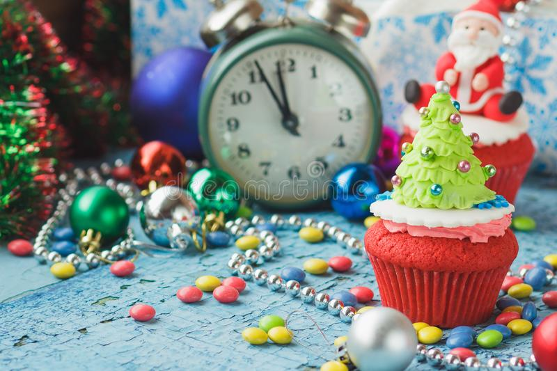 Christmas cupcake with colored decorations. Christmas Tree made from confectionery mastic, soft focus background royalty free stock photography