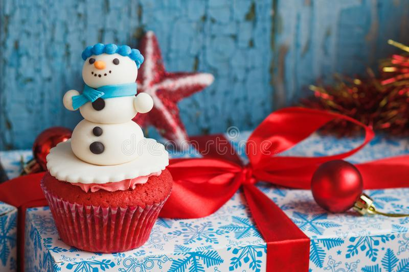 Christmas cupcake with colored decorations. Made from confectionery mastic, soft focus background stock photos