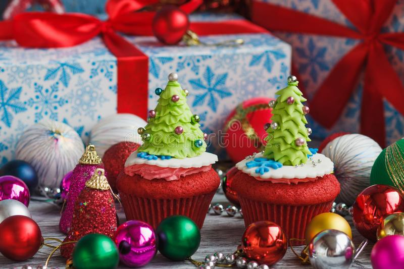 Christmas cupcake with colored decorations. Made from confectionery mastic, soft focus background royalty free stock photos