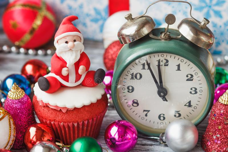 Christmas cupcake with colored decorations. Santa Claus made from confectionery mastic, soft focus background stock images
